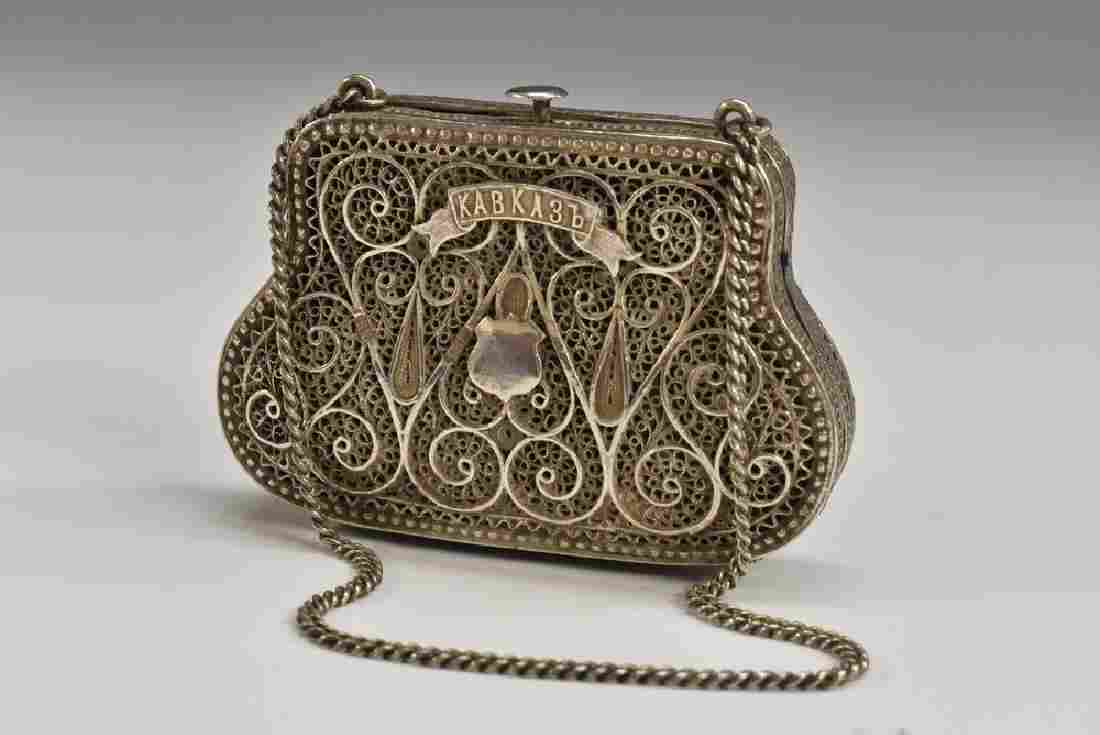 A Russian silver silver filigree bag shaped purse,