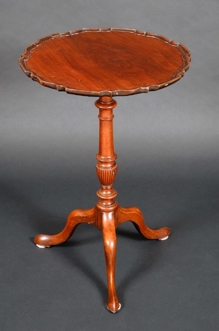 A Chippendale design mahogany shaped circular tripod