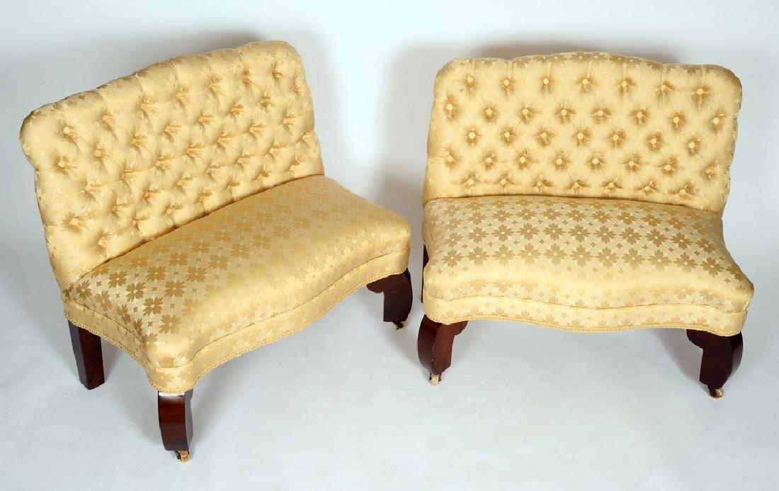 A pair of 19th century mahogany window seat sofas, of