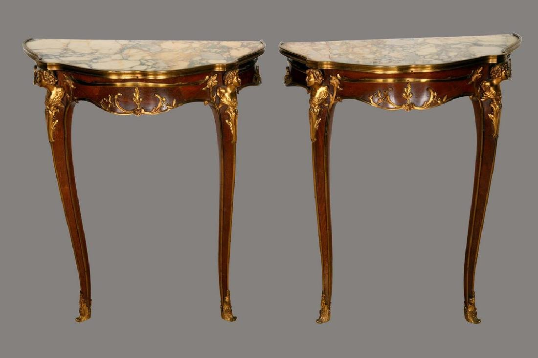 A pair of Louis XV style gilt metal mounted mahogany