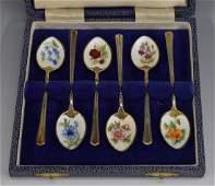 A set of six Elizabeth II silver-gilt and enamel coffee
