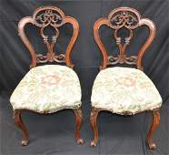 A pair of Victorian walnut side chairs, cartouche