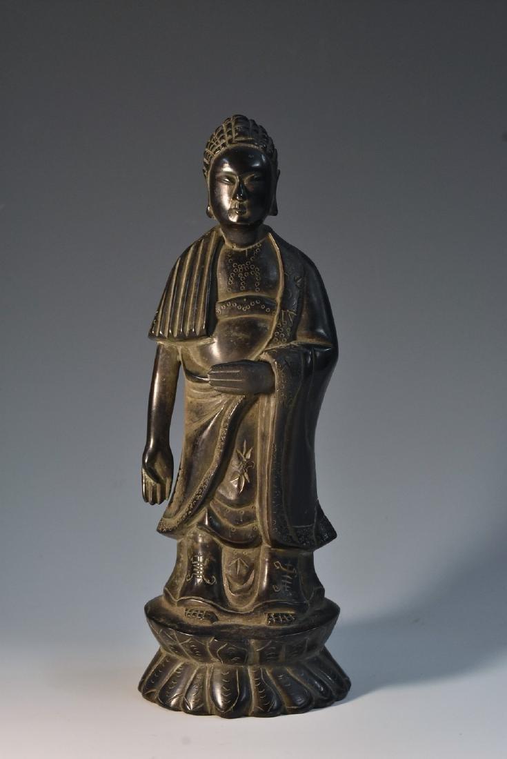 Chinese School, a dark patinated bronze, Buddha,