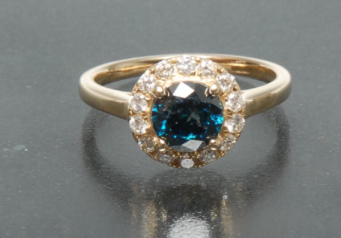 A fancy blue and white diamond ring, central round