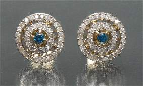 A pair of fancy blue and white diamond target earrings
