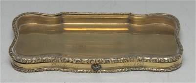 An unusual William IV silver gilt shaped rectangular