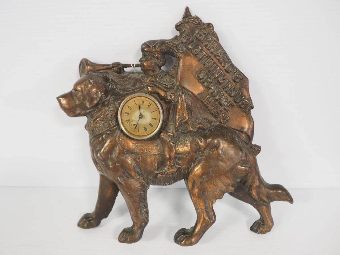 Cast iron Erham's Clothing advertising clock