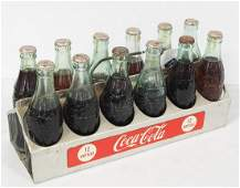 Coca Cola bottle carrier with bottles