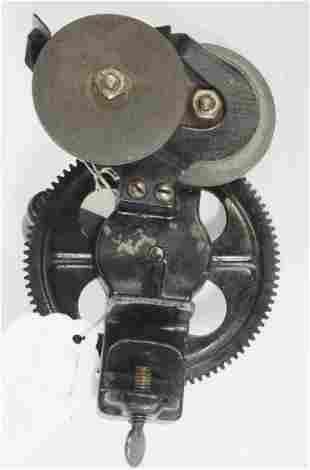 Small hand-crank bench grinder