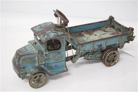 Arcade cast iron dump truck with driver