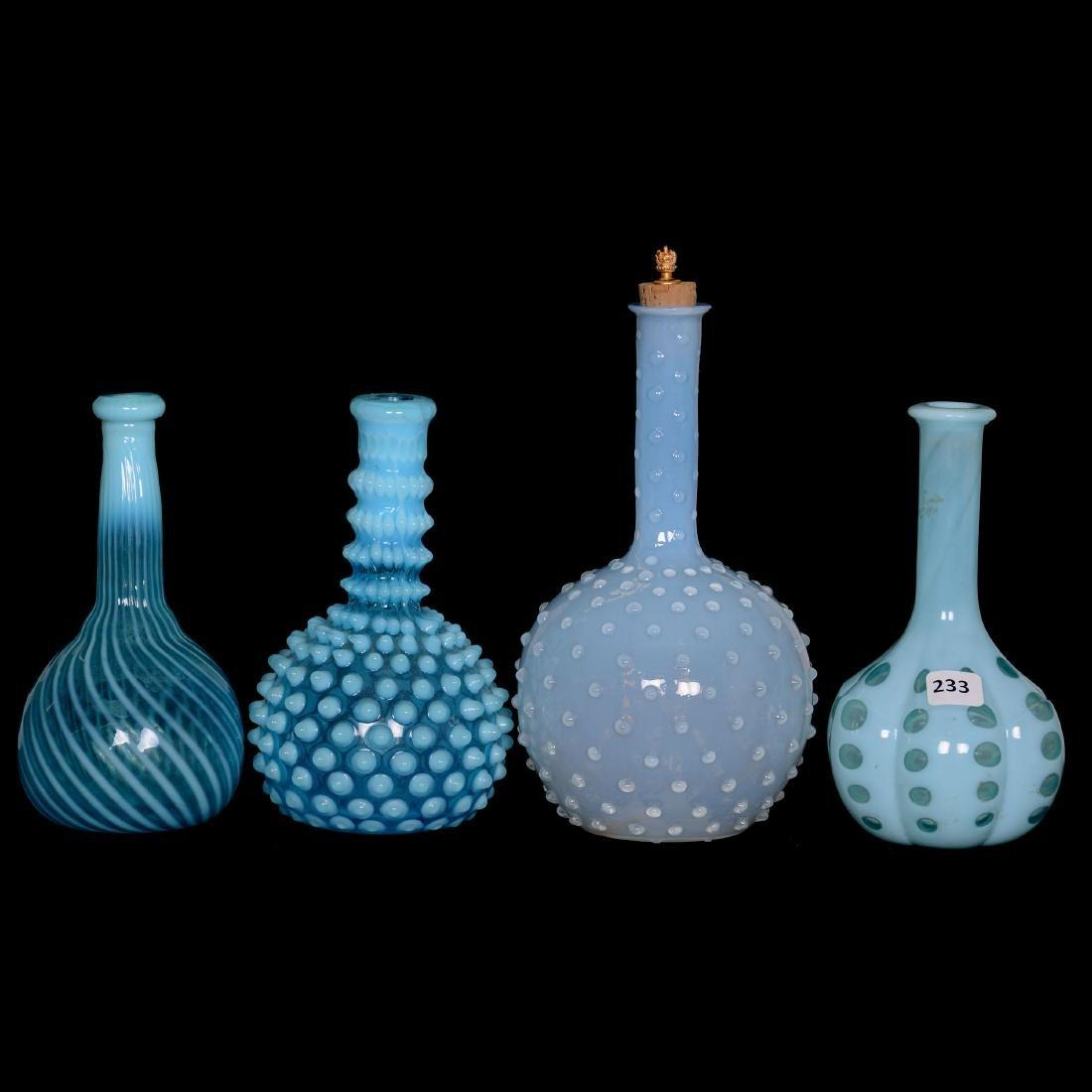 (4) Blue Opalescent Barber Bottles