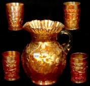9 CARNIVAL GLASS WATER PITCHER AND FIVE MATCHING TUMBL