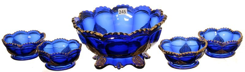 FIVE PIECE COBALT BLUE PATTERN GLASS BERRY SET BY NORTH