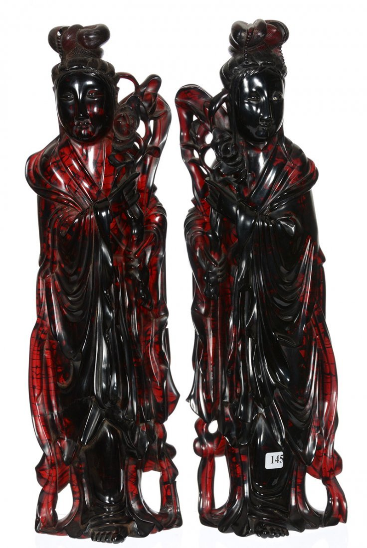 "PAIR 20"" CARVED RED AMBER-STYLE ORIENTAL FIGURES"