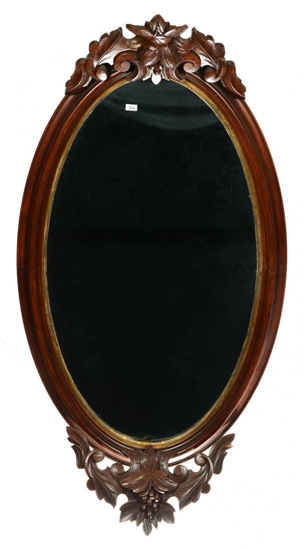"49"" X 25"" OVAL HANGING WALNUT MIRROR WITH CARVED FRUIT"