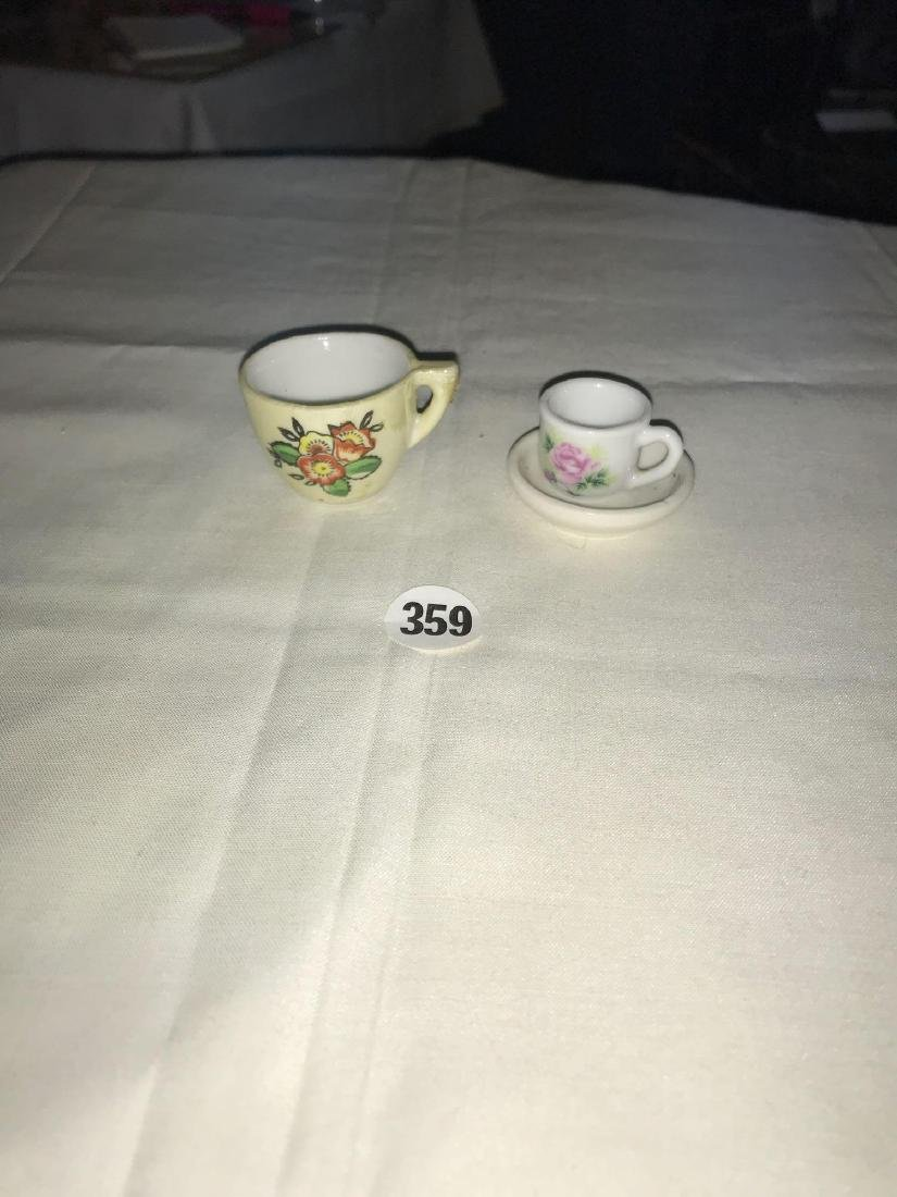 Tiny cup and cup with saucer