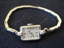 14k Gold Movado Ladies Wristwatch w Diamonds
