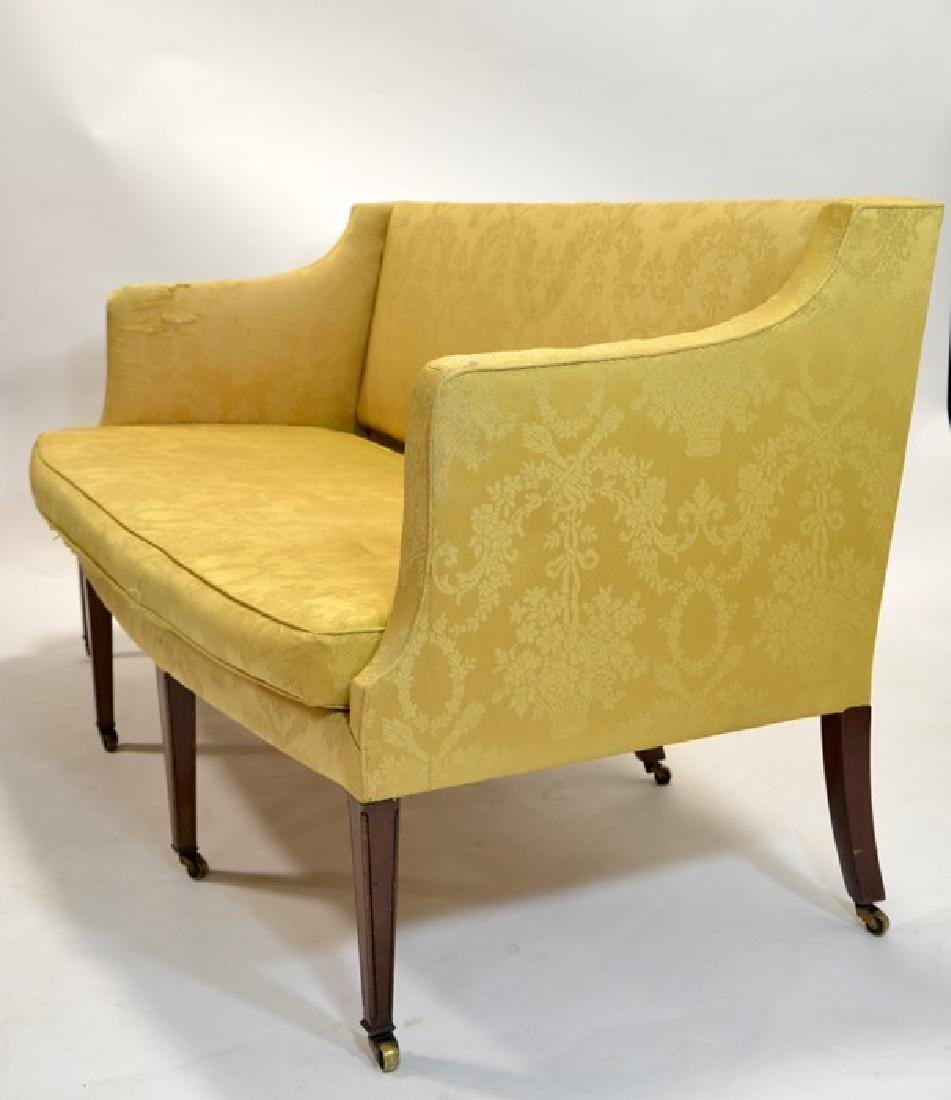 An Edwardian three seater sofa, bow fronted on four - 2