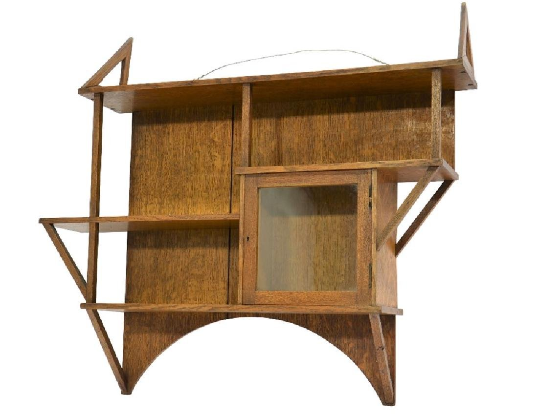 Liberty and Co., an Arts and Crafts oak wall shelf, in