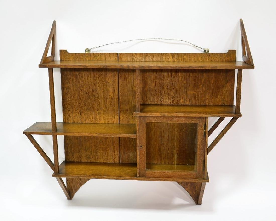 Liberty and Co., an Arts and Crafts oak wall shelf, in - 2