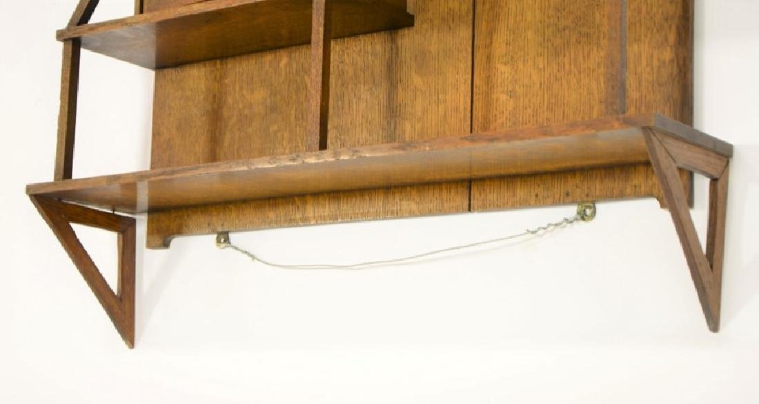 Liberty and Co., an Arts and Crafts oak wall shelf, in - 3
