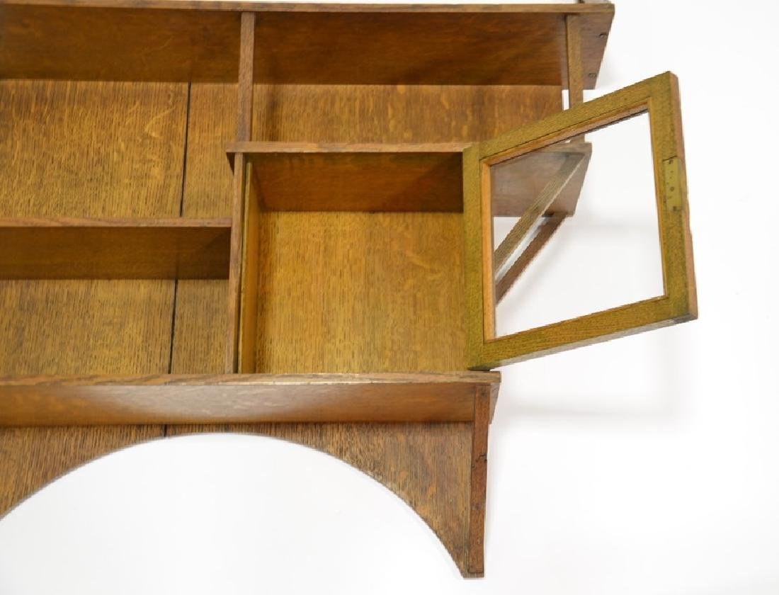 Liberty and Co., an Arts and Crafts oak wall shelf, in - 4