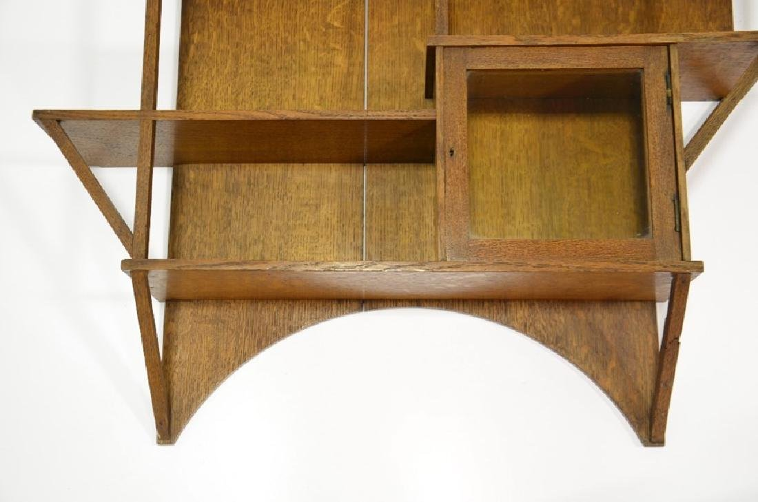 Liberty and Co., an Arts and Crafts oak wall shelf, in - 5