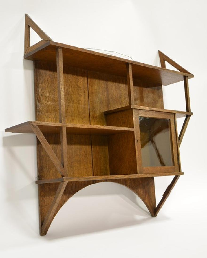 Liberty and Co., an Arts and Crafts oak wall shelf, in - 6