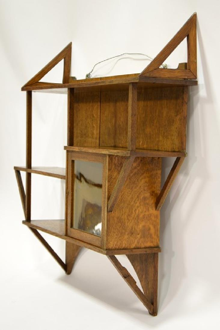 Liberty and Co., an Arts and Crafts oak wall shelf, in - 7
