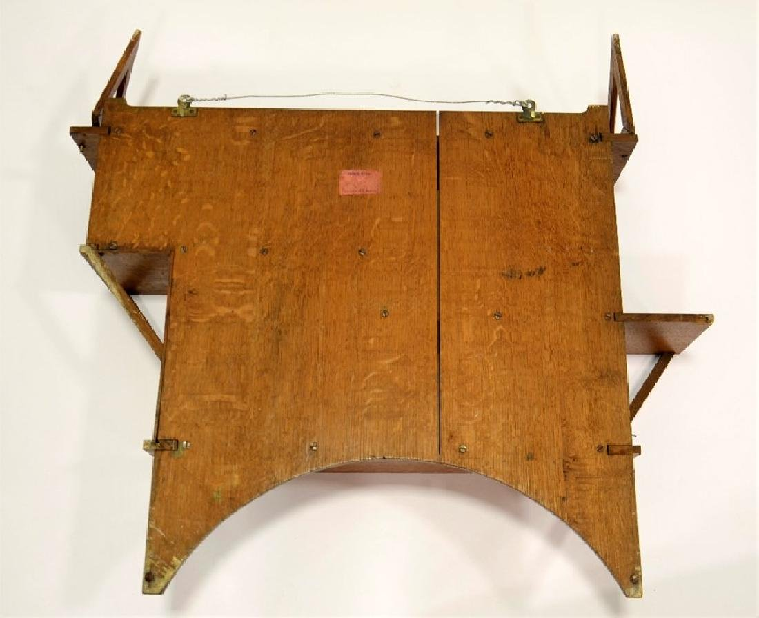 Liberty and Co., an Arts and Crafts oak wall shelf, in - 8