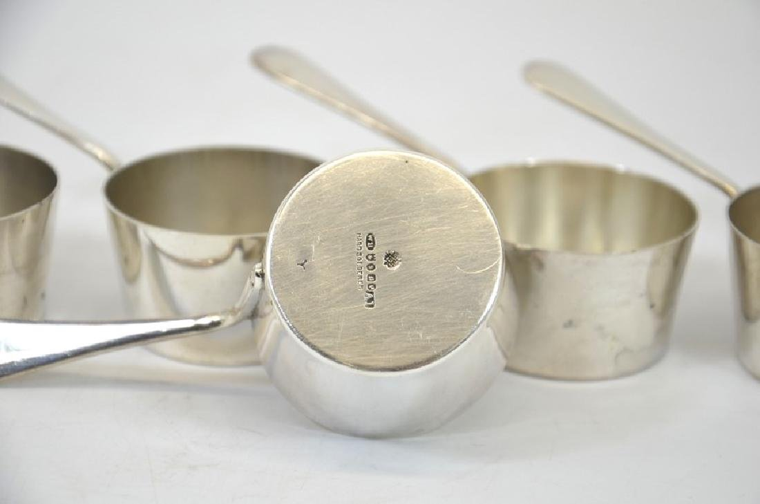 A set of five silver plated miniature sauce pans or - 4