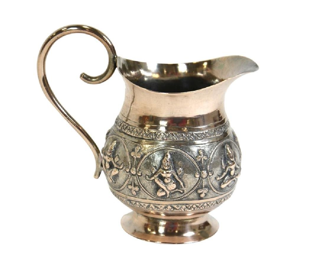 An Indian white metal jug, 19th century, footed