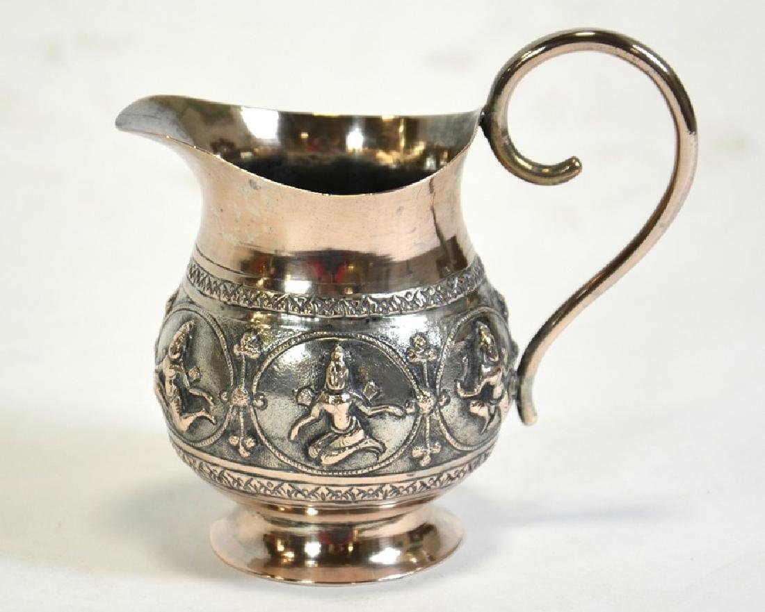 An Indian white metal jug, 19th century, footed - 2