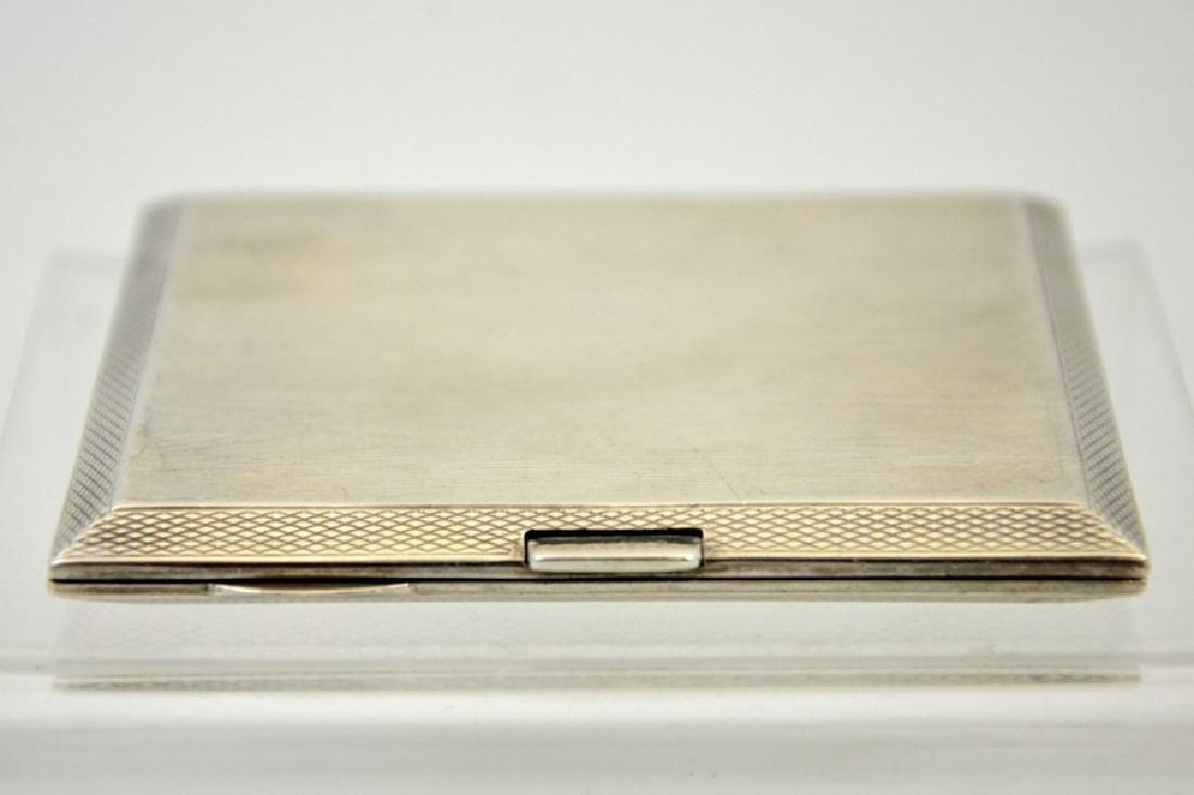 A silver cigarette box by S Blanckensee & Son Ltd,