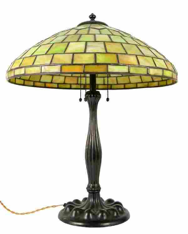 A Tiffany style leaded glass table lamp, the marbled