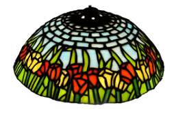 A Tiffany style leaded and stained glass might shade