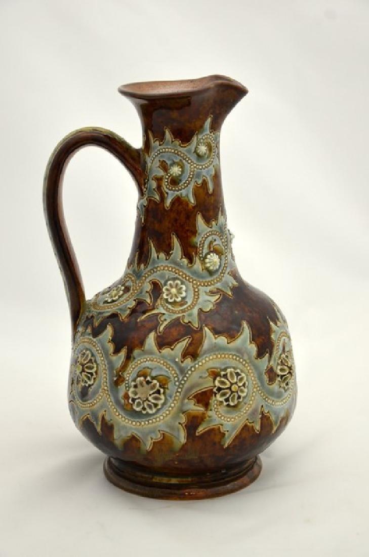 George Tinworth for Doulton Lambeth, a stoneware jug,
