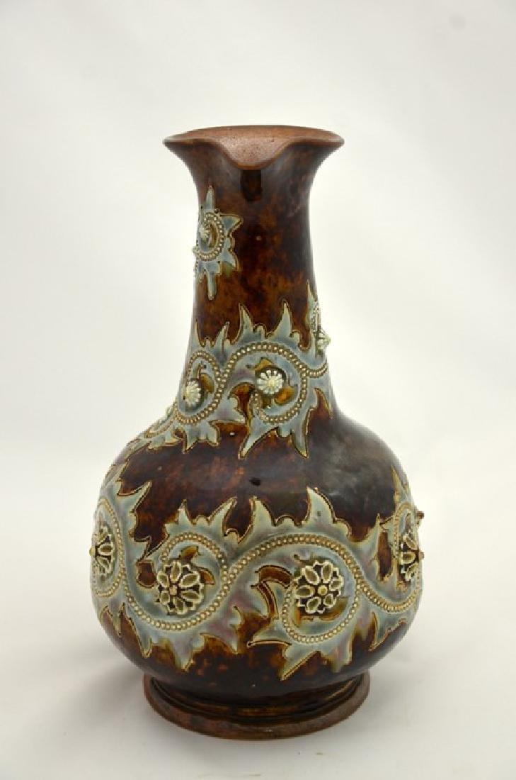 George Tinworth for Doulton Lambeth, a stoneware jug, - 2
