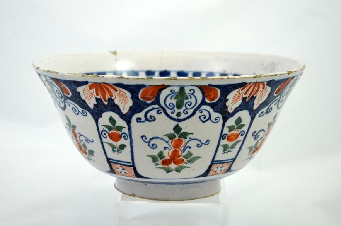 An English delft steep sided polychrome punch bowl,