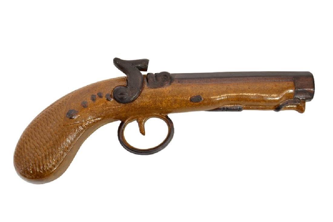 J Bourne, a Denby Pottery salt glazed stoneware pistol