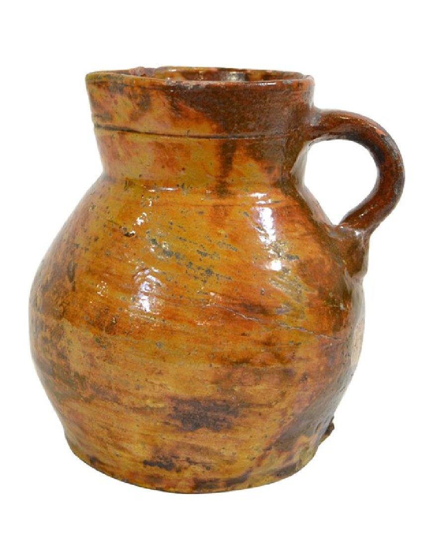 A mid to late 18th century West Country cider jug,