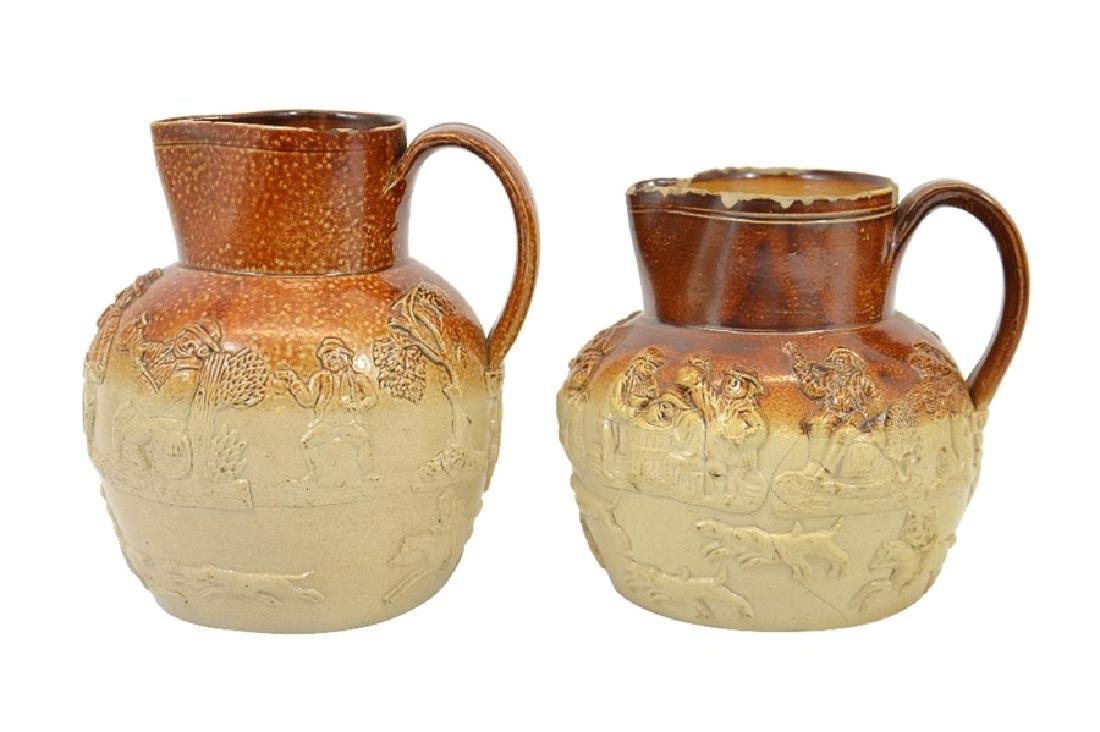Two 19th century salt glazed stoneware hunting jugs,