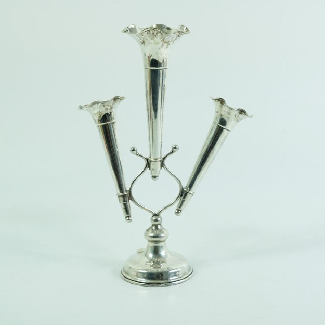 An Edwardian silver epergne, Cohen and Charles,
