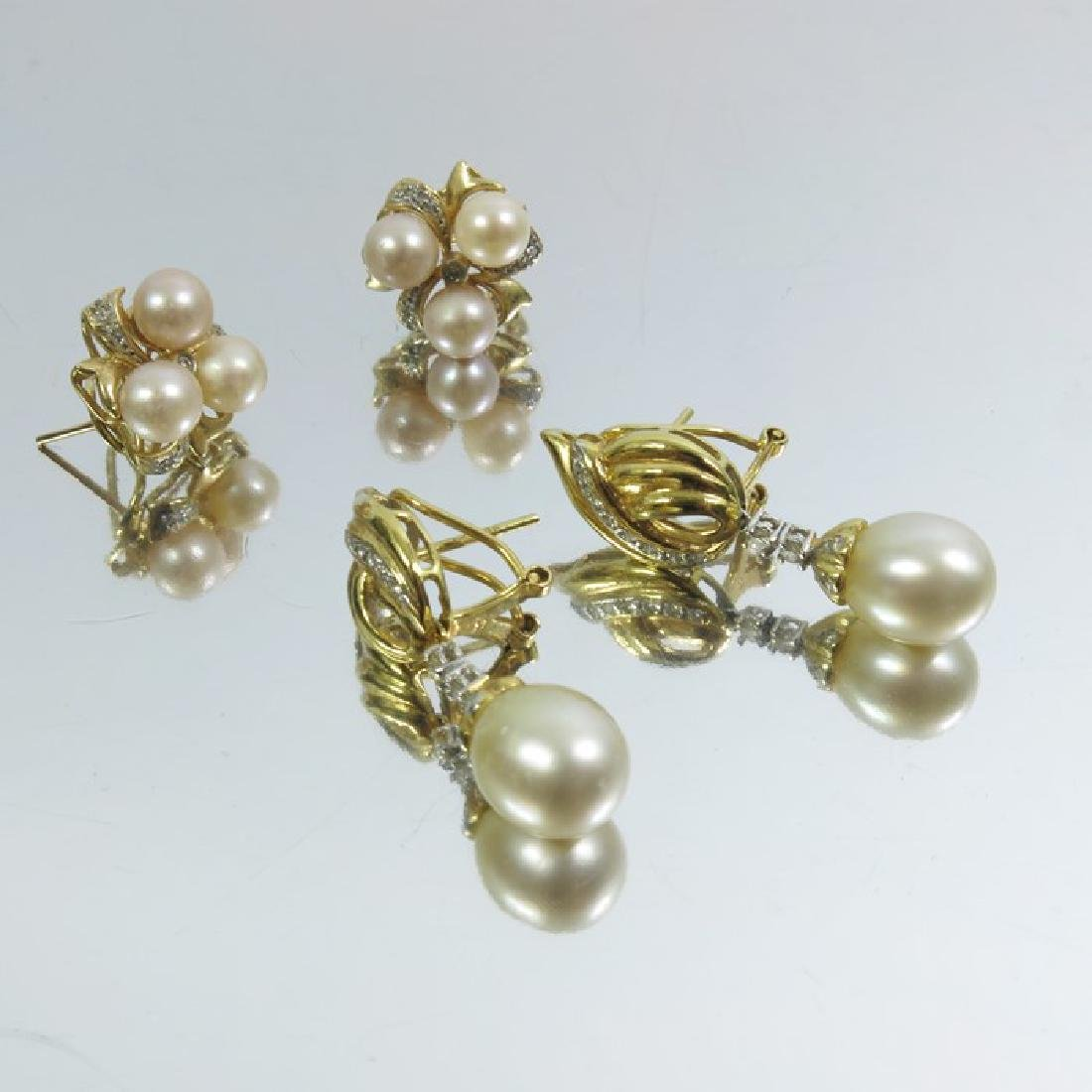 Two pairs of pearl and diamond earrings, set in yellow