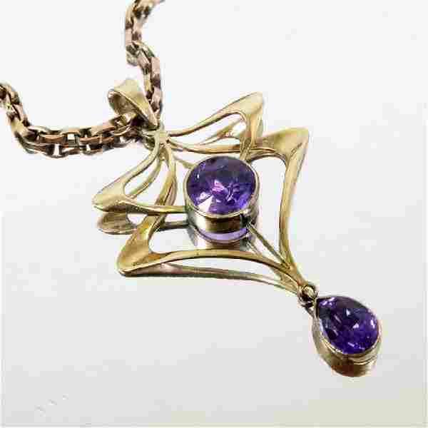 An Art Nouveau 9 carat gold and amethyst pendant, on