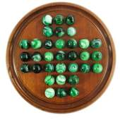 A mahogany solitaire board on bun feet, with 33 emerald