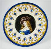 A French faience plate, late 19th century, decorated