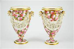 A pair of Swansea porcelain urn shape vases having twin