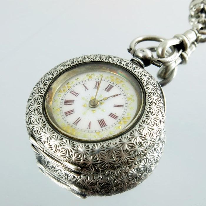 A Victorian silver fob watch on chain, chased, the dial