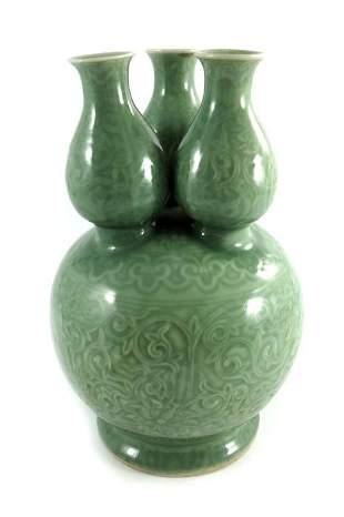 A Chinese celadon ground triple necked gourd vase
